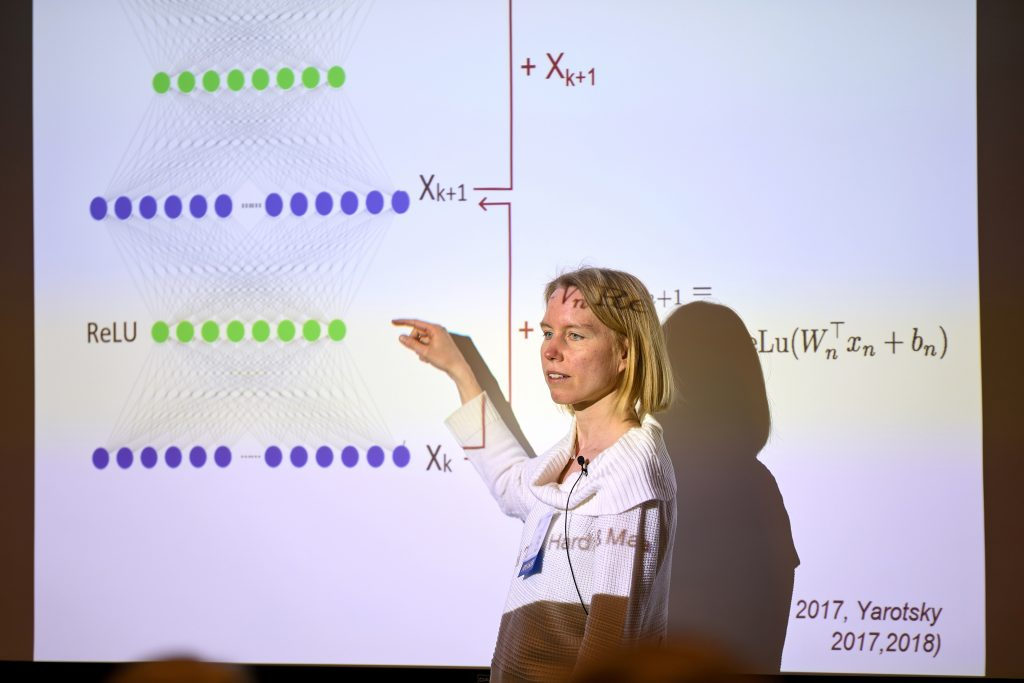 "MIT associate professor of electrical engineering and computer science Stefanie Jegelka, an IDSS affiliate, gives a talk at the 2019 Women in Data Science (WiDS) Cambridge conference entitled, ""What Can Neural Networks Represent?"" Photo: Dana J. Quigley"
