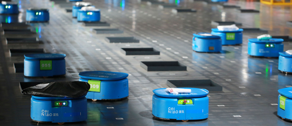 Robots operated by Alibaba's logistics unit Cainiao, move parcels at a new automated guided vehicles (AGV) warehouse inside the hub of delivery company YTO Express, in Hangzhou, Zhejiang province, China September 14, 2018. Picture taken September 14, 2018. REUTERS/Stringer