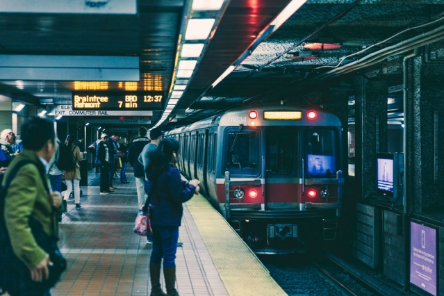 Commuters wait for a Red Line subway train, part of Boston's public transit system. A new study by MIT researchers shows that low-income people use mass transit significantly more often when they have access to fare reductions.