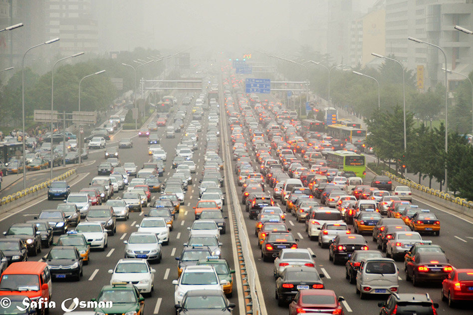 Photo: Motor vehicle traffic in Beijing contributes to particulate and ozone pollution that could be reduced by China's climate policy, resulting in fewer premature deaths and significant cost savings (Source: Flickr/Safia Osman)