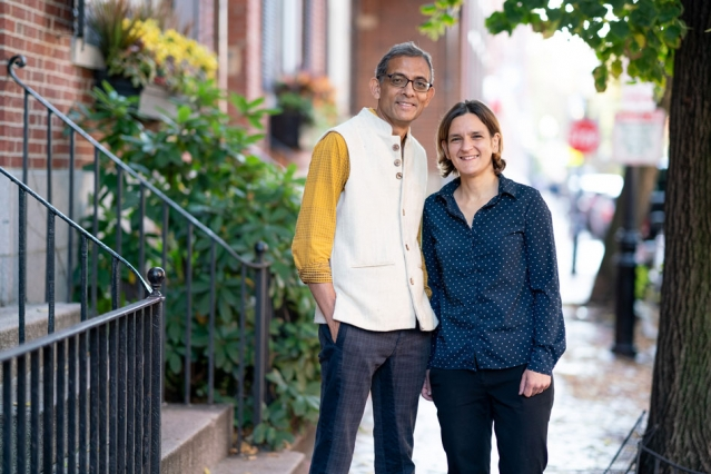 MIT economists Abhijit Banerjee and Esther Duflo stand outside their home after learning that they have been named co-winners of the 2019 Nobel Prize in economic sciences. They will share the prize with Michael Kremer of Harvard University. Photo: Bryce Vickmark