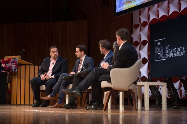 """The panel, """"Work of the Future Policy Levers: People, Places and Institutions,"""" which focused on how public policy can be shaped to help technology benefit society, included (from left): Daron Acemoglu, Michael Kratsios, Erik Brynjolfsson, Sarita Gupta, and Alastair Fitzpayne."""