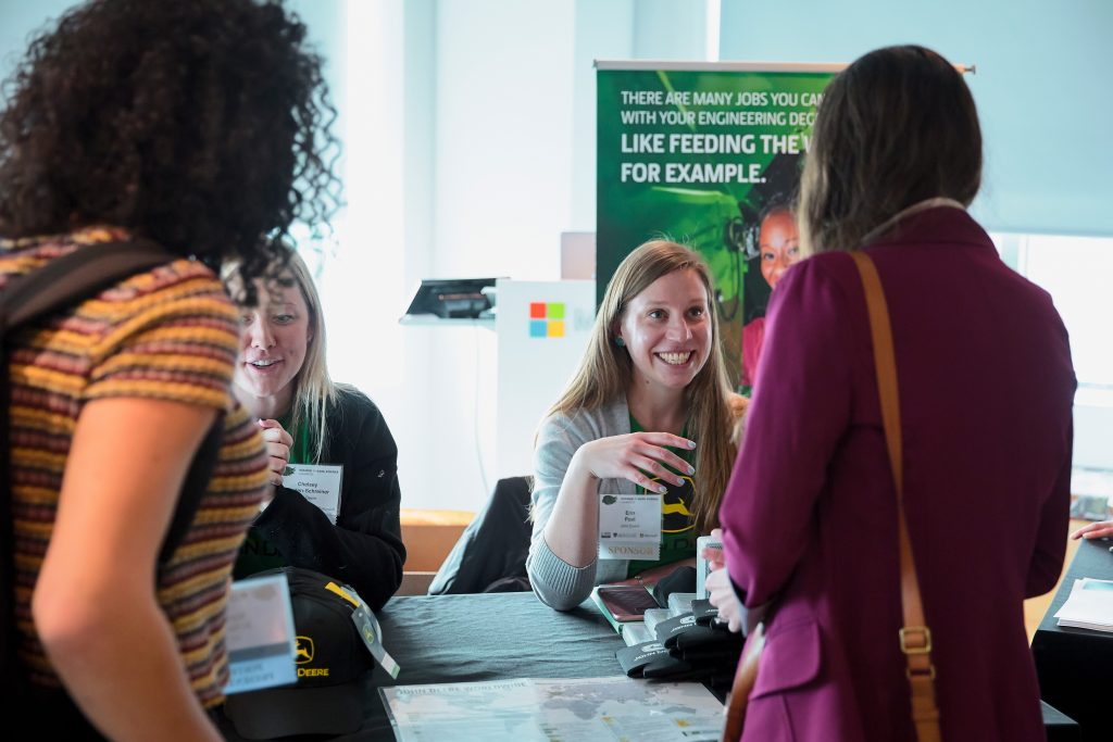 representatives from John Deere greet attendees of the 2020 Women in Data Science conference in Cambridge MA