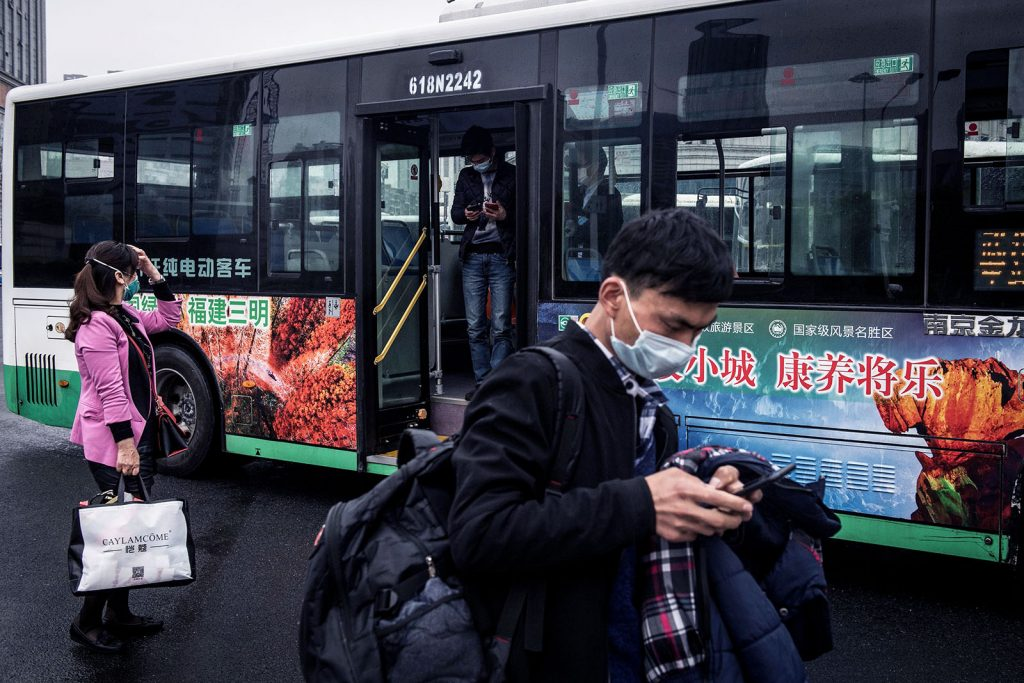 People exit a bus in China, after the public transportation partly resumed. Even during the worst moments of the pandemic, everybody believes and expects that public transport will recover in Asia. Photo: STR/AFP via Getty Images
