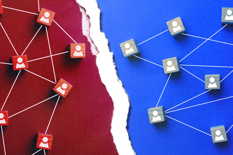 A matrix of connected red and connected blue icons facing off across a divide
