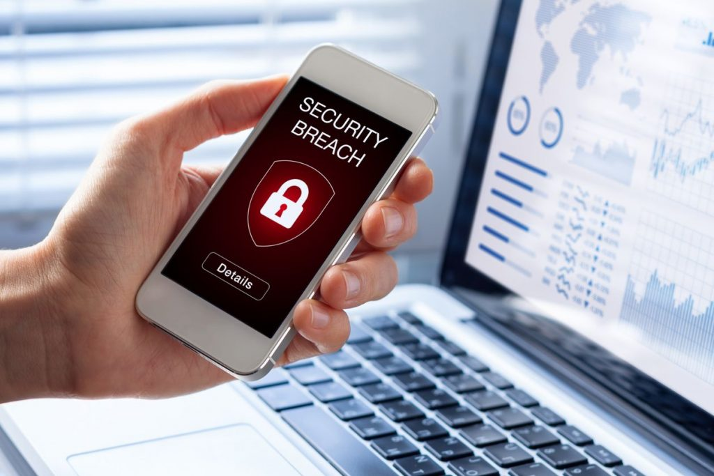 stock photo of an iphone showing a security breach alarm