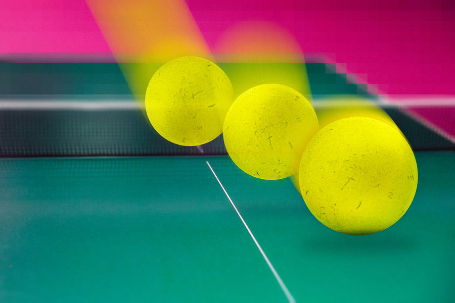 stock image of a tennis ball landing on a court